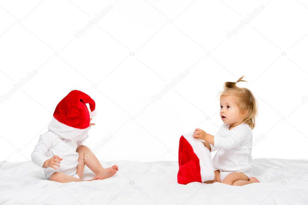 toddlers in santa hats