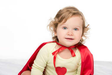 adorable toddler in superhero cape