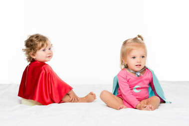 toddler girls in superhero capes