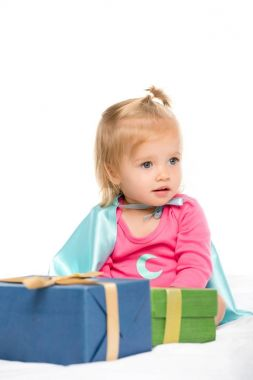 baby with wrapped gifts