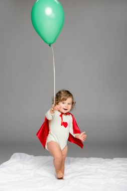 happy toddler with balloon