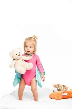 toddler girl with teddy bear