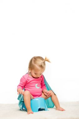 toddler girl sitting on pottie
