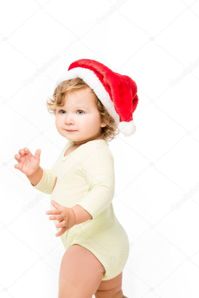 toddler girl in santa hat