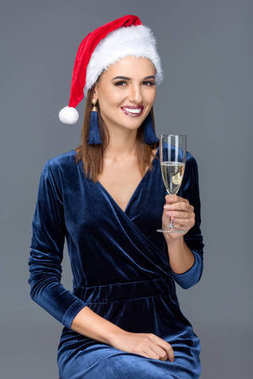 woman in santa hat with champagne