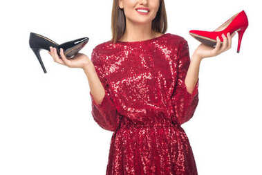 woman holding high heeled shoes