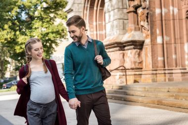 husband and wife walking on street