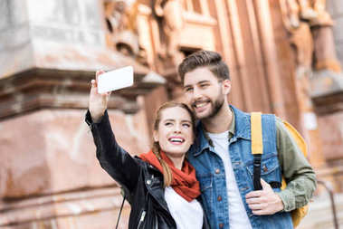 couple taking selfie together