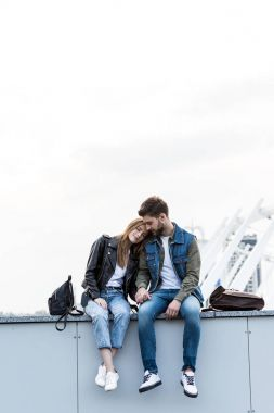 couple resting on parapet
