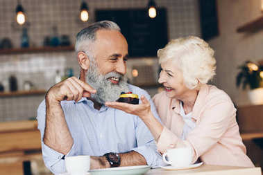elderly couple at table in cafe