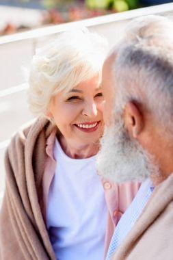 happy senior woman looking at husband