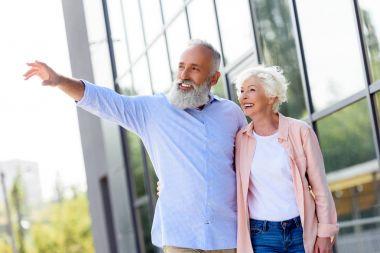 man showing something to wife
