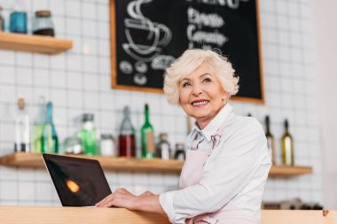 coffee shop owner with laptop