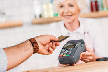 Cropped shot of visitor paying for order with credit card in cafe stock vector