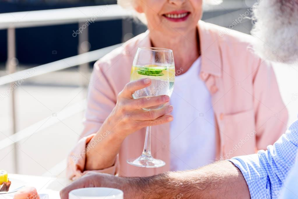 senior woman with drink