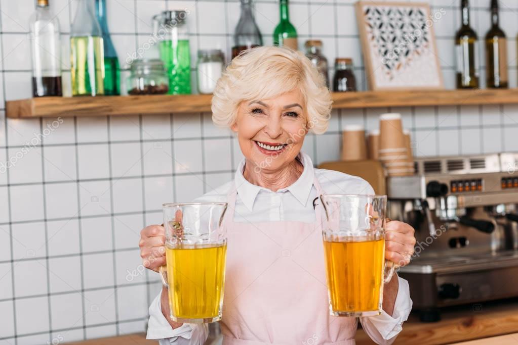 cafe worker with glass jars of lemonade