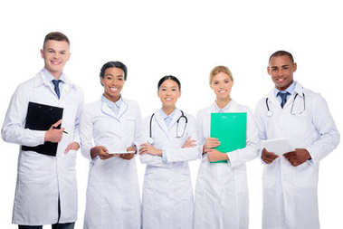 multiethnic doctors with stethoscopes, clipboard and tablet