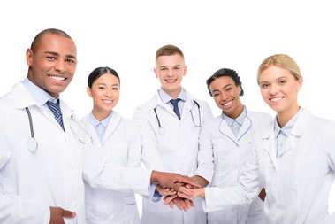 multiethnic doctors with hands together