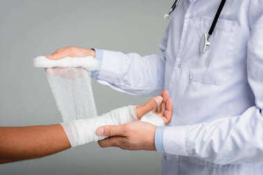 doctor puting bandage on hand
