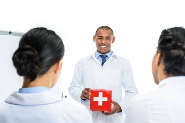 doctor presenting first aid kit