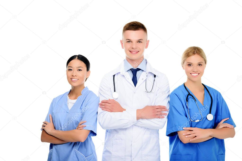 surgeons and doctor with crossed arms