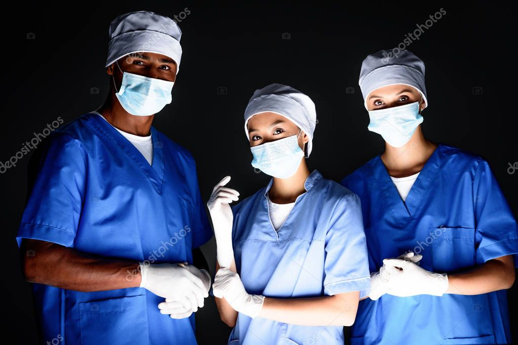 multiethnic surgeons in medical masks