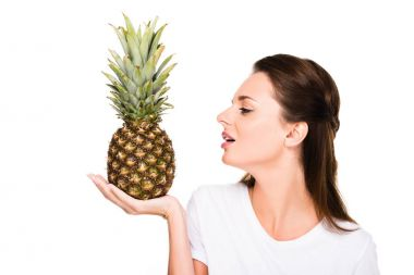 woman with fresh pineapple