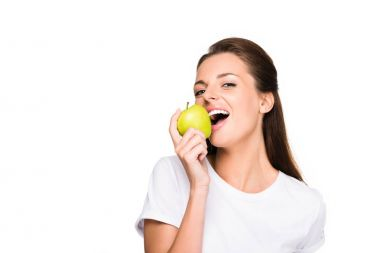 Portrait of young woman biting fresh apple isolated on white stock vector