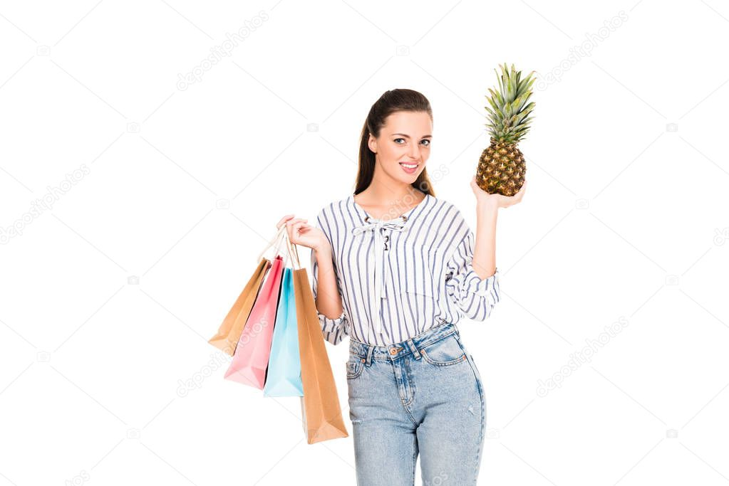 woman with pineapple and shopping bags