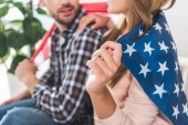 Photo couple wrapped in American flag