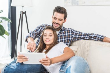 attractive couple using tablet