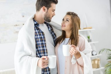 couple with coffee and plaid