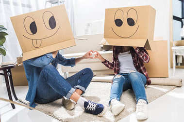 couple with boxes on heads