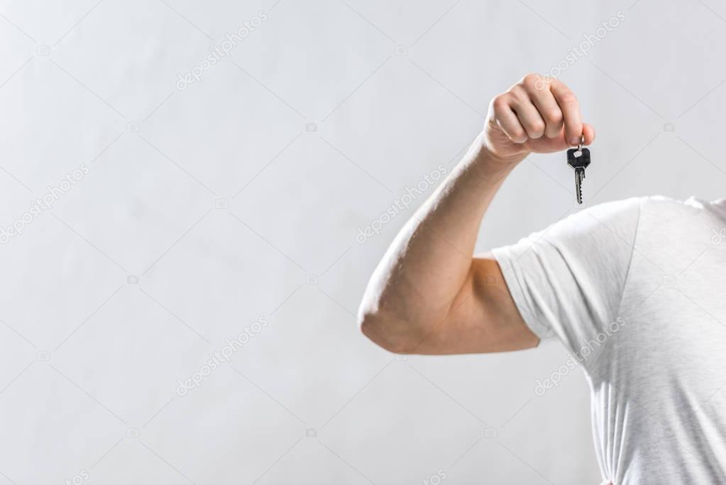 man showing key