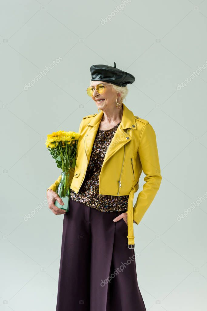 stylish senior woman with flowers