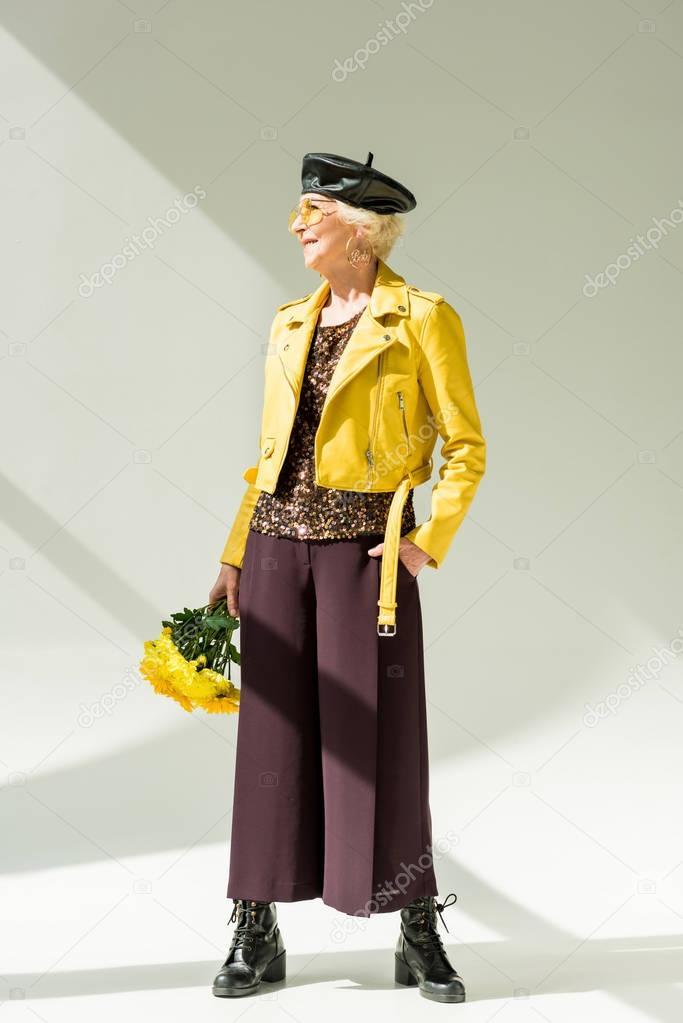 stylish senior woman with bouquet