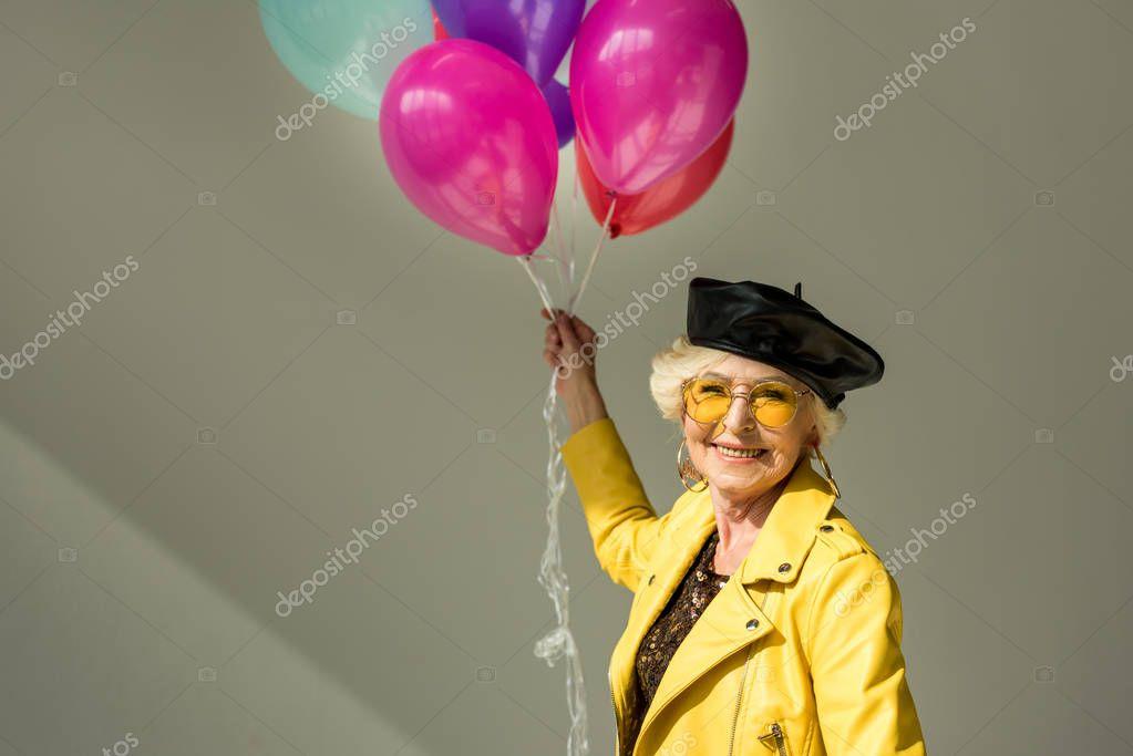 senior woman with balloons