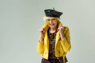 senior lady in leather beret