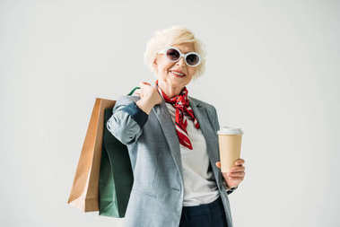 senior woman with shopping bags and coffee