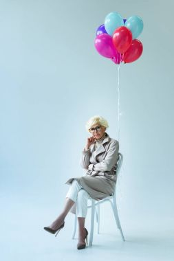 senior lady with balloons