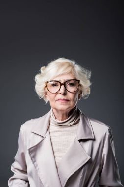 senior lady in trench coat