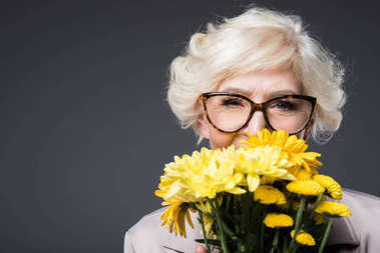happy senior lady with flowers