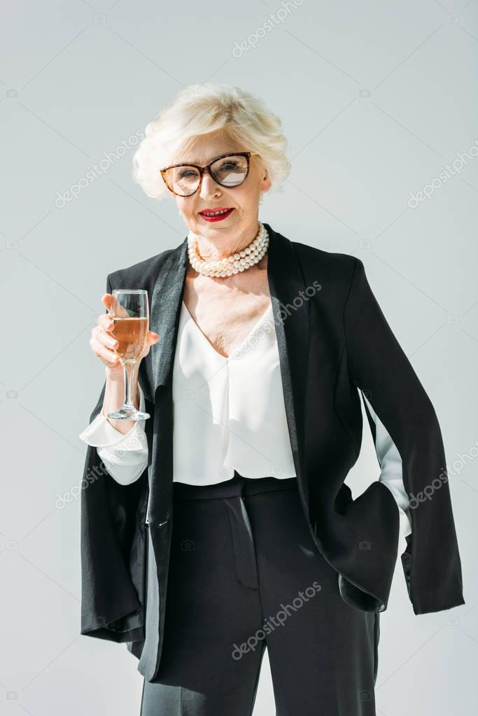 senior lady with champagne