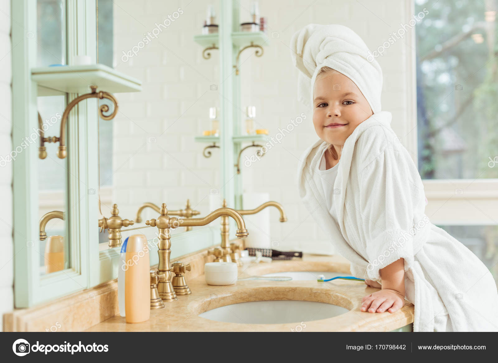090d30ff69 child in bathrobe brushing teeth — Stock Photo © AllaSerebrina ...