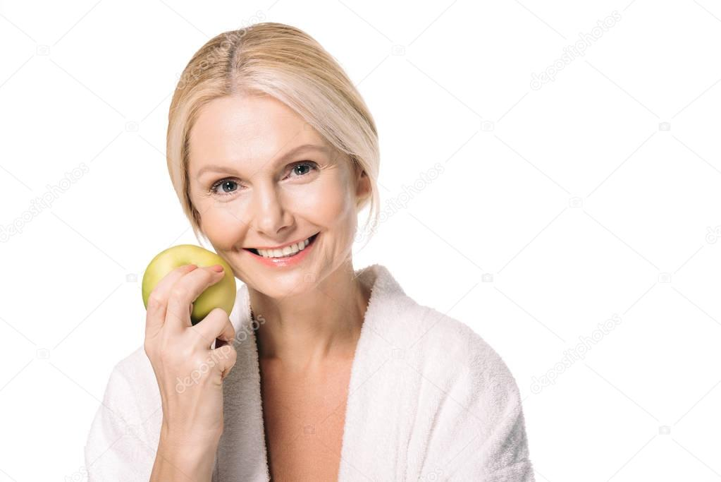 mature woman with green apple