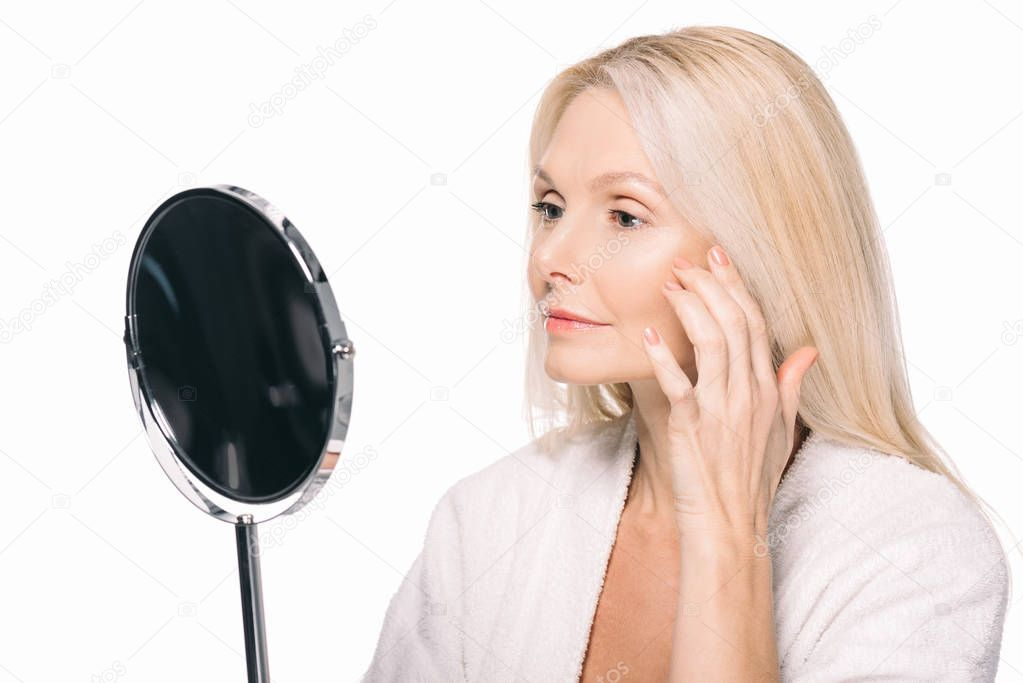 mature woman looking at mirror