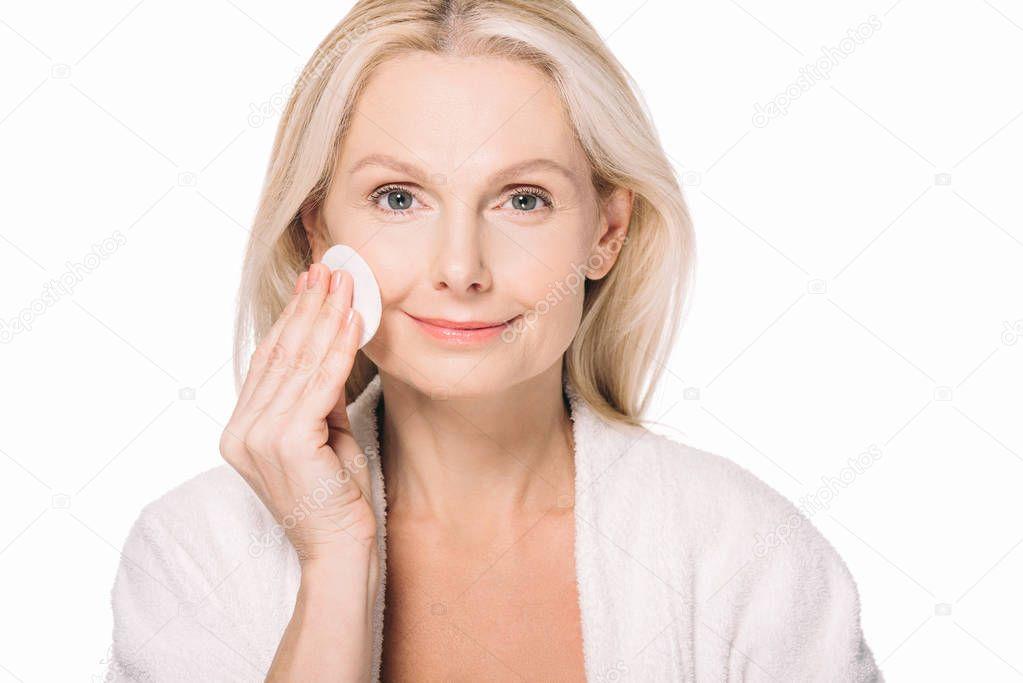 mature woman using cosmetic sponge