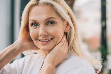 Close-up portrait of beautiful mature woman looking at camera stock vector