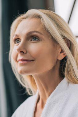 Close-up portrait of beautiful mature woman stock vector