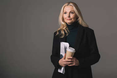 businesswoman with papers and coffee